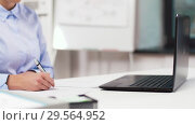 Купить «businesswoman with laptop and papers at office», видеоролик № 29564952, снято 10 декабря 2018 г. (c) Syda Productions / Фотобанк Лори