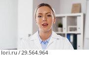 Купить «doctor participating in video call or consultation», видеоролик № 29564964, снято 10 декабря 2018 г. (c) Syda Productions / Фотобанк Лори