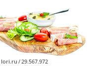 Купить «Pieces of Italian prosciutto on a wooden cutting board», фото № 29567972, снято 12 декабря 2018 г. (c) Татьяна Ляпи / Фотобанк Лори