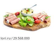 Купить «Pieces of Italian prosciutto on a wooden cutting board», фото № 29568000, снято 12 декабря 2018 г. (c) Татьяна Ляпи / Фотобанк Лори