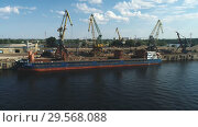 Купить «Aerial view on Recycling, loading scrap metal in the ship on a port», видеоролик № 29568088, снято 8 августа 2018 г. (c) Виктор Аллин / Фотобанк Лори