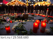 Купить «Germany, Berlin - Commemoration of the victims of the terrorist attack at Christmas Market Breitscheidplatz (Gedaechtniskirche) 2016», фото № 29568680, снято 20 декабря 2017 г. (c) Caro Photoagency / Фотобанк Лори