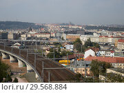 Prague, Hlavni mesto Praha, Czech Republic - View of Karlin. The old town and castle hill in the background. (2018 год). Редакционное фото, агентство Caro Photoagency / Фотобанк Лори