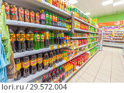 Купить «Russia, Samara, November 2018: a bottle of soft drinks in the supermarket. Text in Russian: lemonade, Russian kvass, tea, pear, barberry, action, lemon, sea buckthorn, green», фото № 29572004, снято 29 ноября 2018 г. (c) Акиньшин Владимир / Фотобанк Лори