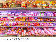 Купить «Russia, Samara, November 2018: Sale of sausage products in the hypermarket. Text in Russian: sausages, wieners, Quality factory, hunting, amateur, action, doctoral, amateur», фото № 29572040, снято 30 ноября 2018 г. (c) Акиньшин Владимир / Фотобанк Лори