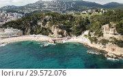 Купить «View from drone of Castell d'en Plaja in Mediterranean coastal town of Lloret de Mar, Catalonia, Spain», видеоролик № 29572076, снято 11 июня 2018 г. (c) Яков Филимонов / Фотобанк Лори