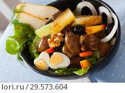 Купить «Salad of chicken hearts with peach, pear, fried cheese, quail eggs», фото № 29573604, снято 22 мая 2019 г. (c) Яков Филимонов / Фотобанк Лори