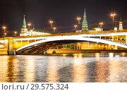 Купить «Stone Bridge near Kremlin (at night)-- the most popular view of Moscow, Russia», фото № 29575324, снято 28 сентября 2014 г. (c) Владимир Журавлев / Фотобанк Лори