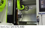 Купить «The robot arm sets the parts for machining in the CNC milling center», видеоролик № 29575440, снято 26 октября 2018 г. (c) Андрей Радченко / Фотобанк Лори