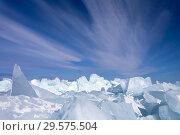 Купить «Natural icy cold background of Baikal Lake in winter. Blue ice blocks and hummocks under a blue sky with beautiful stratus clouds», фото № 29575504, снято 8 марта 2015 г. (c) Виктория Катьянова / Фотобанк Лори