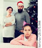 Купить «Parents lecturing daughter at Christmas», фото № 29575944, снято 29 февраля 2020 г. (c) Яков Филимонов / Фотобанк Лори
