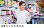 Купить «Female pharmacist suggesting useful body care products», фото № 29576036, снято 31 января 2017 г. (c) Яков Филимонов / Фотобанк Лори
