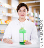 Купить «Pharmacist ready to assist in choosing at counter», фото № 29576040, снято 31 января 2017 г. (c) Яков Филимонов / Фотобанк Лори