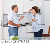 Купить «Upset elderly man and woman quarrelling at home kitchen indoors», фото № 29576192, снято 6 сентября 2018 г. (c) Яков Филимонов / Фотобанк Лори