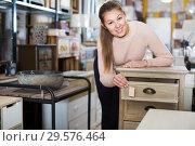 Купить «Female choosing commode in store», фото № 29576464, снято 15 ноября 2017 г. (c) Яков Филимонов / Фотобанк Лори