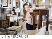 Купить «Girl customer choosing bedside in the furniture shop», фото № 29576468, снято 15 ноября 2017 г. (c) Яков Филимонов / Фотобанк Лори
