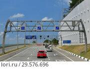 Купить «Sochi, Russia - June 2 2018. Traffic and road signs on A-147 highway», фото № 29576696, снято 2 июня 2018 г. (c) Володина Ольга / Фотобанк Лори