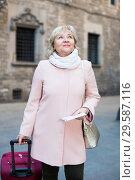 Купить «Mature woman with map and baggage», фото № 29587116, снято 27 ноября 2017 г. (c) Яков Филимонов / Фотобанк Лори