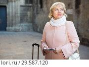Купить «Mature woman with map and baggage», фото № 29587120, снято 27 ноября 2017 г. (c) Яков Филимонов / Фотобанк Лори