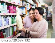 Купить «Two women choosing shampoo», фото № 29587132, снято 18 апреля 2019 г. (c) Яков Филимонов / Фотобанк Лори