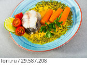 Купить «Steamed hake by served with vegetable pate, boiled carrots, lemon and greens», фото № 29587208, снято 17 июля 2019 г. (c) Яков Филимонов / Фотобанк Лори