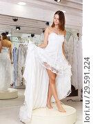 Купить «Woman dressed in white gown», фото № 29591224, снято 17 сентября 2018 г. (c) Яков Филимонов / Фотобанк Лори