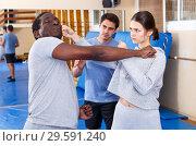 Купить «People fighting with coach at gym», фото № 29591240, снято 31 октября 2018 г. (c) Яков Филимонов / Фотобанк Лори