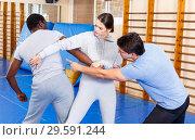 Купить «People fighting with coach at gym», фото № 29591244, снято 31 октября 2018 г. (c) Яков Филимонов / Фотобанк Лори
