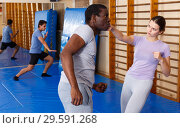 Купить «People practicing self defense techniques», фото № 29591268, снято 31 октября 2018 г. (c) Яков Филимонов / Фотобанк Лори
