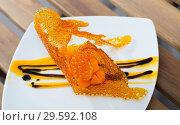 Купить «Close up of tasty dessert of sweet carrots cubes with caramel and vanilla sauce», фото № 29592108, снято 24 марта 2019 г. (c) Яков Филимонов / Фотобанк Лори