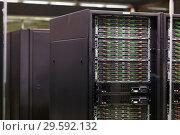 Купить «Closeup of hardware of data center», фото № 29592132, снято 15 января 2018 г. (c) Яков Филимонов / Фотобанк Лори