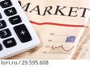Купить «Калькулятор на газете с финансовыми новостями», фото № 29595608, снято 23 января 2010 г. (c) Александр Гаценко / Фотобанк Лори