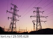 Купить «Опора ЛЭП с высоковольтными проводами на закате», фото № 29595628, снято 4 мая 2009 г. (c) Александр Гаценко / Фотобанк Лори