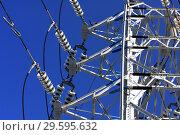 Купить «Опора ЛЭП с высоковольтными проводами на фоне голубого неба», фото № 29595632, снято 28 февраля 2010 г. (c) Александр Гаценко / Фотобанк Лори