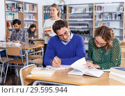 Купить «Young people preparing for exam in library», фото № 29595944, снято 14 ноября 2018 г. (c) Яков Филимонов / Фотобанк Лори