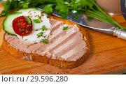 Купить «Pate on toasted bread with fresh cheese on wooden board», фото № 29596280, снято 25 мая 2019 г. (c) Яков Филимонов / Фотобанк Лори