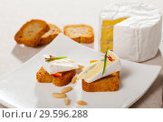 Купить «Canapes with soft blue cheese and orange», фото № 29596288, снято 23 июля 2019 г. (c) Яков Филимонов / Фотобанк Лори