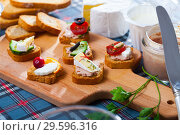 Купить «Canape with soft blue cheese and vegetables», фото № 29596316, снято 23 марта 2019 г. (c) Яков Филимонов / Фотобанк Лори
