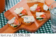 Купить «Toasted bread slices with salmon and cambozola», фото № 29596336, снято 24 января 2019 г. (c) Яков Филимонов / Фотобанк Лори