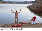 Купить «Nude Santa Claus by lake», фото № 29598520, снято 20 декабря 2017 г. (c) age Fotostock / Фотобанк Лори