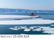 Купить «Spring on Baikal Lake. White ice floats floating on the blue water of the Small Sea Strait. Cormorants flew to the stone Edor islet», фото № 29600824, снято 10 мая 2015 г. (c) Виктория Катьянова / Фотобанк Лори