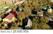Купить «Top view of the village near Moscow in the fall, Russia», видеоролик № 29600956, снято 18 января 2019 г. (c) Володина Ольга / Фотобанк Лори