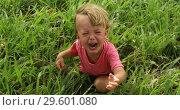 Купить «Sad crying toddler pulls his hands up», видеоролик № 29601080, снято 20 декабря 2018 г. (c) Ekaterina Demidova / Фотобанк Лори