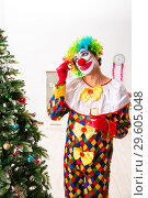 Купить «The funny clown in christmas celebration concept», фото № 29605048, снято 20 июля 2018 г. (c) Elnur / Фотобанк Лори