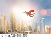 Купить «The superhero businessman flying over the city», фото № 29606556, снято 14 декабря 2019 г. (c) Elnur / Фотобанк Лори