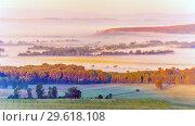 Купить «Misty morning over the valley in the Ural mountains», фото № 29618108, снято 30 августа 2018 г. (c) Акиньшин Владимир / Фотобанк Лори