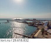 Купить «Sochi, Russia - June 2. 2018. View of seaport from the shore», фото № 29618832, снято 2 июня 2018 г. (c) Володина Ольга / Фотобанк Лори