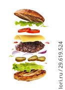 Купить «Delicious hamburger with flying ingredients isolated on white background. Freshly brewed burger closeup», фото № 29619524, снято 17 марта 2018 г. (c) Сергей Чайко / Фотобанк Лори