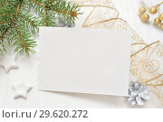 Купить «Empty white sheet of paper on a white Christmas background of fir branches and cones. Letter on xmas, mockup», фото № 29620272, снято 12 декабря 2017 г. (c) Happy Letters / Фотобанк Лори