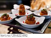 Купить «A Portion of potato snack with pomegranate», фото № 29622692, снято 6 апреля 2018 г. (c) Володина Ольга / Фотобанк Лори